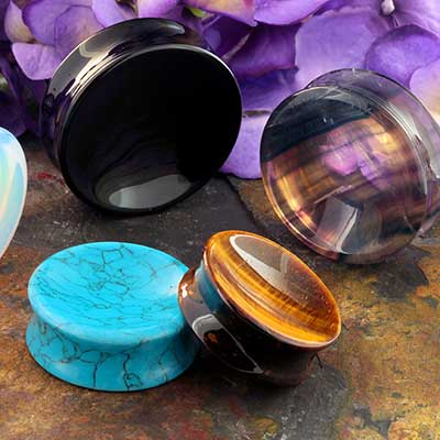 Concave Stone and Glass Plugs